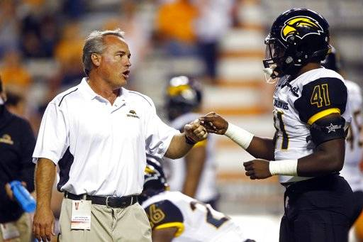 Southern Mississippi head coach Jay Hopson bumps fist with linebacker Racheem Boothe (41) during warmups before an NCAA college football game against Tennessee, Saturday, Nov. 4, 2017, in Knoxville, Tenn.
