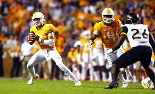 Tennessee quarterback Jarrett Guarantano (2) rolls out to pass in the first half of an NCAA college football game against Southern Mississippi Saturday, Nov. 4, 2017, in Knoxville, Tenn.