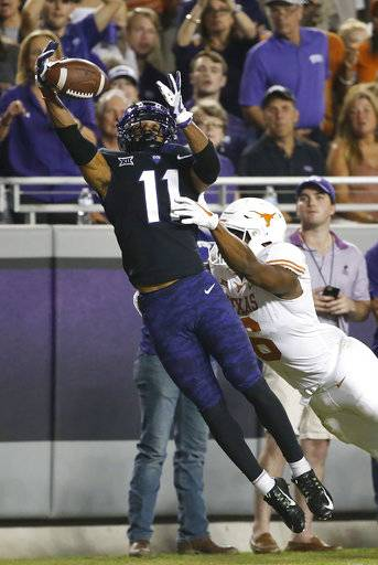 TCU cornerback Ranthony Texada (11) breaks up a pass intended for Texas wide receiver Devin Duvernay (6) during the first half of an NCAA college football game Saturday, Nov. 4, 2017, in Fort Worth, Texas.