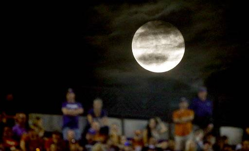 The moon rises as Texas plays TCU during the second half of an NCAA college football game Saturday, Nov. 4, 2017, in Fort Worth, Texas. TCU won 24-7.