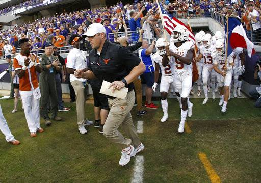 Texas coach Tom Herman takes the field with his team before an NCAA college football game against TCU on Saturday, Nov. 4, 2017, in Fort Worth, Texas. TCU won 24-7.