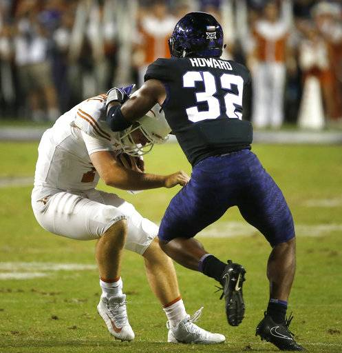 Texas quarterback Shane Buechele (7) is tackled by TCU linebacker Travin Howard (32) during the first half of an NCAA college football game Saturday, Nov. 4, 2017, in Fort Worth, Texas.