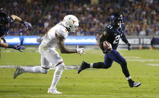 TCU running back Kyle Hicks (21) runs for a touchdown against Texas defensive back DeShon Elliott (4) during the first half of an NCAA college football game Saturday, Nov. 4, 2017, in Fort Worth, Texas.