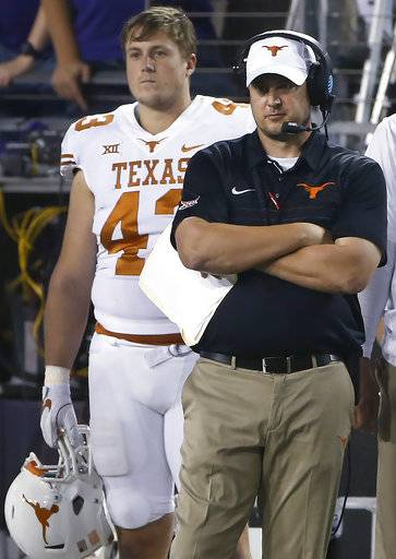 Texas coach Tom Herman and tight end Robert Willis (43) watch from the sideline as Texas plays TCU during the second half of an NCAA college football game Saturday, Nov. 4, 2017, in Fort Worth, Texas. TCU won 24-7.