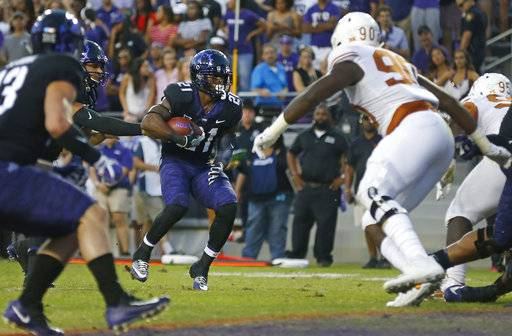 TCU running back Kyle Hicks (21) runs for touchdown against Texas during the first half of an NCAA college football game Saturday, Nov. 4, 2017, in Fort Worth, Texas.