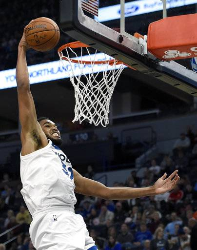 Minnesota Timberwolves center Karl-Anthony Towns (32) dunks against the Dallas Mavericks during the first half of an NBA basketball game on Saturday, Nov. 4, 2017, in Minneapolis. The Timberwolves won 112-99.