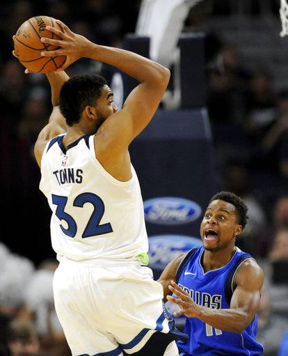 Dallas Mavericks guard Yogi Ferrell (11) guards against Minnesota Timberwolves center Karl-Anthony Towns (32) during the second half of an NBA basketball game on Saturday, Nov. 4, 2017, in Minneapolis. The Timberwolves won 112-99.