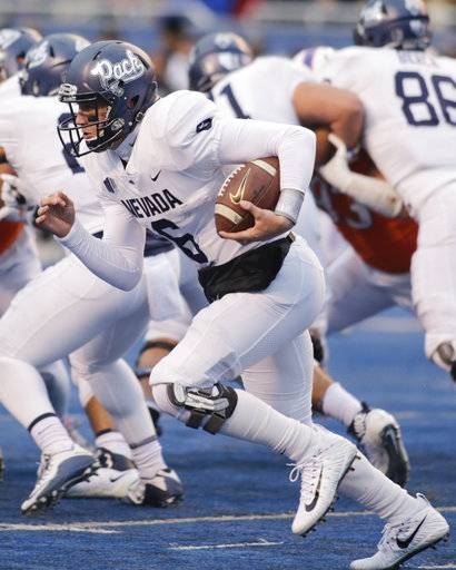 Nevada quarterback Ty Gangi (6) runs the ball during the first half of an NCAA college football game against Boise State in Boise, Idaho, Saturday, Nov. 4, 2017.