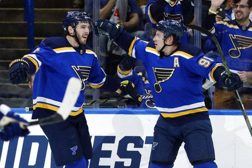 St. Louis Blues' Joel Edmundson, left, is congratulated by St. Louis Blues' Vladimir Tarasenko, of Russia, after scoring during the second period of an NHL hockey game against the Toronto Maple Leafs Saturday, Nov. 4, 2017, in St. Louis.