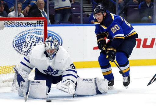 Toronto Maple Leafs goalie Frederik Andersen, of Denmark, reaches for a loose puck as St. Louis Blues' Alexander Steen, right, watches during the second period of an NHL hockey game Saturday, Nov. 4, 2017, in St. Louis.