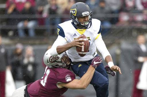 Northern Arizona quarterback Stone Smart, top, is sacked by Montana defensive end Chris Favoroso (43) in the first half of an NCAA college football game Saturday, Nov. 4, 2017, in Missoula, Mont.