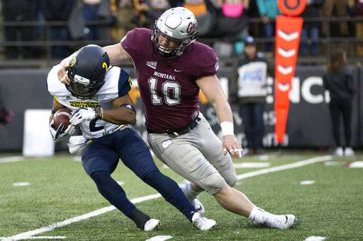 Montana linebacker Connor Strahm (10) tackles Northern Arizona running back Nate Stinson (2) for a loss of yards in an NCAA college football game Saturday, Nov. 4, 2017, in Missoula, Mont.