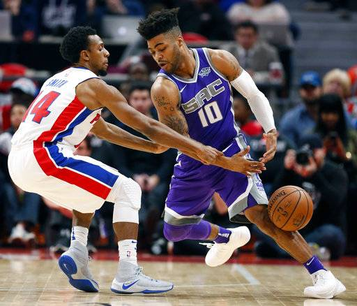 Detroit Pistons guard Ish Smith (14) fouls Sacramento Kings guard Frank Mason III (10) while trying to steal the ball during the first half of an NBA basketball game Saturday, Nov. 4, 2017, in Detroit.