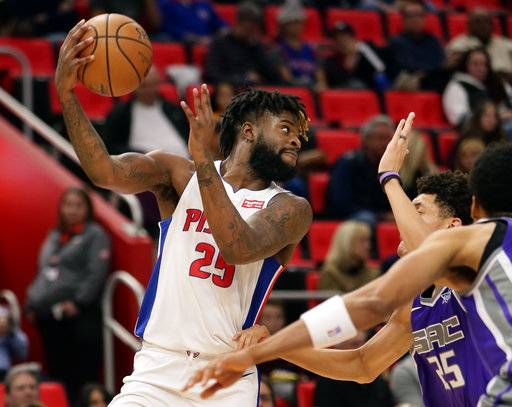 Detroit Pistons forward Reggie Bullock (25) passes the ball against the Sacramento Kings during the first half of an NBA basketball game Saturday, Nov. 4, 2017, in Detroit.
