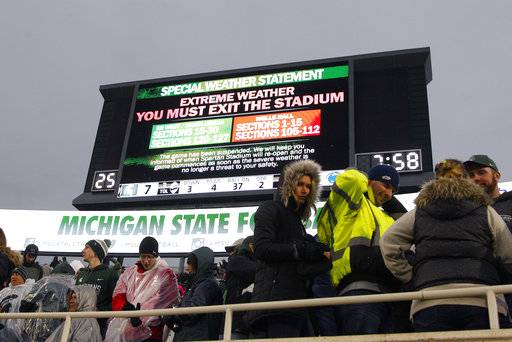 The Michigan State-Penn State NCAA college football game is delayed by weather during the first half, Saturday, Nov. 4, 2017, in East Lansing, Mich.