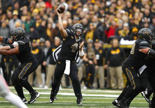 Iowa quarterback Nathan Stanley throws a pass during the first half of an NCAA college football game against Ohio State, Saturday, Nov. 4, 2017, in Iowa City, Iowa.