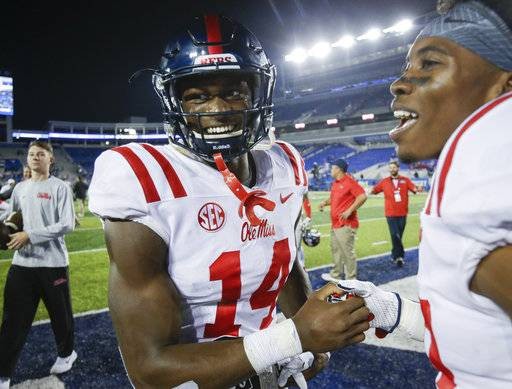 Mississippi wide receiver D.K. Metcalf (14) celebrates after his touchdown reception won an NCAA college football game in the final play of the second half against Kentucky, Saturday, Nov. 4, 2017, in Lexington, Ky.