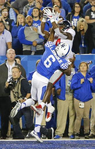 Mississippi wide receiver D.K. Metcalf catches a winning touchdown over Kentucky cornerback Lonnie Johnson on the final play of the second half of an NCAA college football game Saturday, Nov. 4, 2017, in Lexington, Ky.