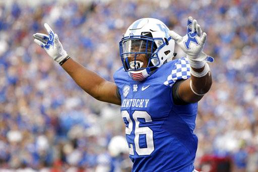 Kentucky running back Benny Snell Jr. celebrates after scoring a touchdown during the first half of an NCAA college football game against Mississippi, Saturday, Nov. 4, 2017, in Lexington, Ky.