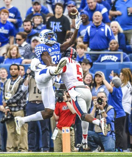Kentucky  receiver Isaiah Epps (81) makes a catch against Mississippi defensive back Ken Webster (5) during an NCAA college football game in Lexington, Ky., Saturday, Nov. 4, 2017. (Bruce Newman/The Oxford Eagle via AP)