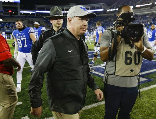 Kentucky head coach Mark Stoops leaves the field after being defeated by Mississippi in an NCAA college football game Saturday, Nov. 4, 2017, in Lexington, Ky.