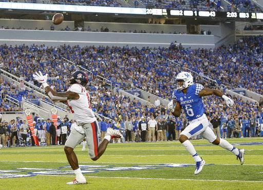 Mississippi wide receiver D.K. Metcalf catches a touchdown pass in front of Kentucky cornerback Lonnie Johnson during the second half of an NCAA college football game Saturday, Nov. 4, 2017, in Lexington, Ky.