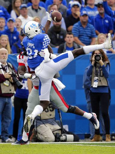 Kentucky wide receiver Isaiah Epps catches a pass over Mississippi defensive back Ken Webster setting up a touchdown during the first half of an NCAA college football game Saturday, Nov. 4, 2017, in Lexington, Ky.