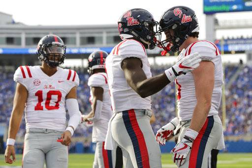 Mississippi wide receiver A.J. Brown celebrates with tight end Dawson Knox, right, after Brown scored a touchdown during the first half of an NCAA college football game against Kentucky, Saturday, Nov. 4, 2017, in Lexington, Ky.