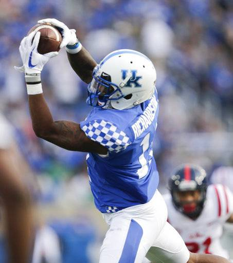 Kentucky wide receiver Tavin Richardson catches a pass for a first down during the first half of an NCAA college football game against Mississippi, Saturday, Nov. 4, 2017, in Lexington, Ky.