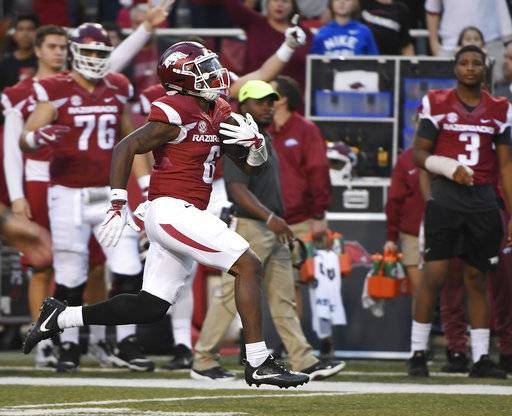 Arkansas running back T.J. Hammonds breaks away from the Coastal Carolina defense to score a touchdown during the second half of an NCAA college football game Saturday, Nov. 4, 2017, in Fayetteville, Ark.