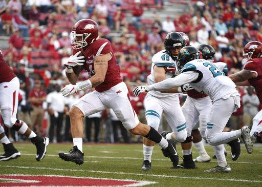 Arkansas tight end Austin Cantrell slips through the Coastal Carolina defense to score a touchdown during the second half of an NCAA college football game Saturday, Nov. 4, 2017, in Fayetteville, Ark.