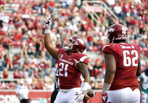 Arkansas running back Devwah Whaley celebrates after scoring a touchdown during the first half of an NCAA college football game against Coastal Carolina, Saturday, Nov. 4, 2017, in Fayetteville, Ark.