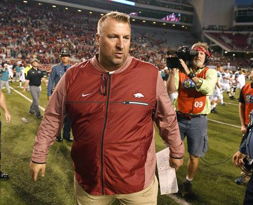 Arkansas coach Bret Bielema heads to the locker room after defeating Coastal Carolina in an NCAA college football game Saturday, Nov. 4, 2017, in Fayetteville, Ark.