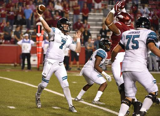 Coastal Carolina quarterback Kilton Anderson drops back to pass against Arkansas during the second half of an NCAA college football game Saturday, Nov. 4, 2017, in Fayetteville, Ark.