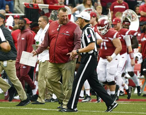Arkansas coach Bret Bielema has a word with the officials as they head to the locker room during halftime against Coastal Carolina during an NCAA college football game Saturday, Nov. 4, 2017, in Fayetteville, Ark.