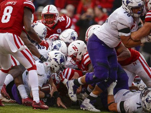 Northwestern quarterback Clayton Thorson (18) scores the go-ahead touchdown behind offensive lineman Rashawn Slater (70), during the second half of an NCAA college football game against Nebraska in Lincoln, Neb., Saturday, Nov. 4, 2017. Northwestern won 31-24 in overtime.