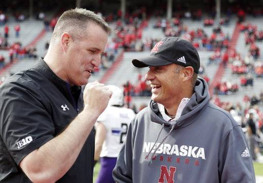 Nebraska head coach Mike Riley, right, and Northwestern head coach Pat Fitzgerald chat before an NCAA college football game in Lincoln, Neb., Saturday, Nov. 4, 2017.