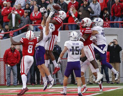Nebraska's Joshua Kalu, top center, Northwestern's Bennett Skowronek (88) and others leap but cannot catch a Hail-Mary throw by Nebraska quarterback Tanner Lee (13), in the final seconds of the second half of an NCAA college football game in Lincoln, Neb., Saturday, Nov. 4, 2017. Northwestern won 31-24 in overtime.