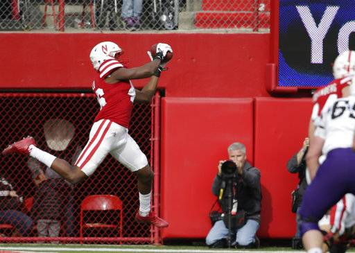 Nebraska defensive back Joshua Kalu (46) intercepts a throw by Northwestern quarterback Clayton Thorson during the first half of an NCAA college football game in Lincoln, Neb., Saturday, Nov. 4, 2017.