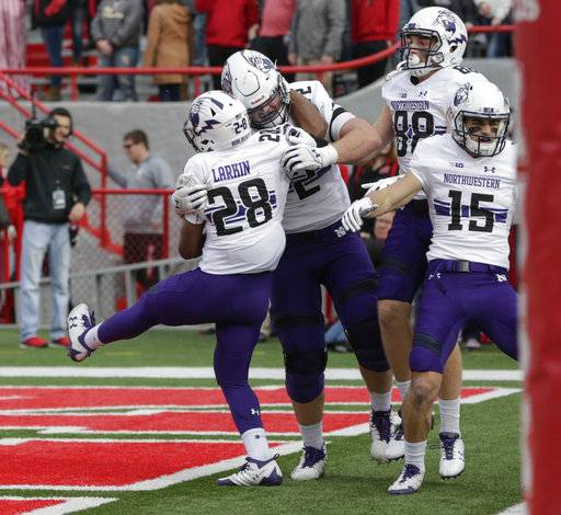 Northwestern players celebrate with running back Jeremy Larkin (28) after he scored a touchdown against Nebraska during the first half of an NCAA college football game in Lincoln, Neb., Saturday, Nov. 4, 2017.