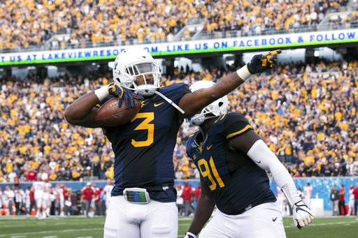 West Virginia's Al-Rasheed Benton (3) celebrates following an interception during the first half of an NCAA college football game against Iowa State in Morgantown, W. Va., Saturday, Nov. 4, 2017.