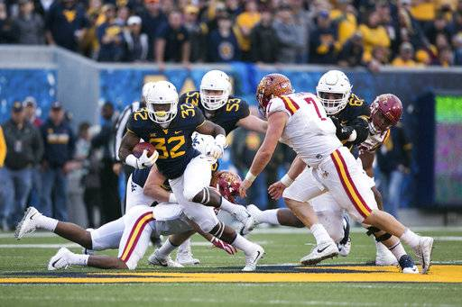 West Virginia Mountaineers running back Martell Pettaway (32) breaks free during the second half of an NCAA college football game against Iowa State in Morgantown, W.Va., Saturday, Nov. 4, 2017.