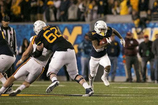 West Virginia running back Kennedy McKoy (4) runs downfield during the second half of an NCAA college football game against Iowa State in Morgantown, W.Va., Saturday, Nov. 4, 2017.