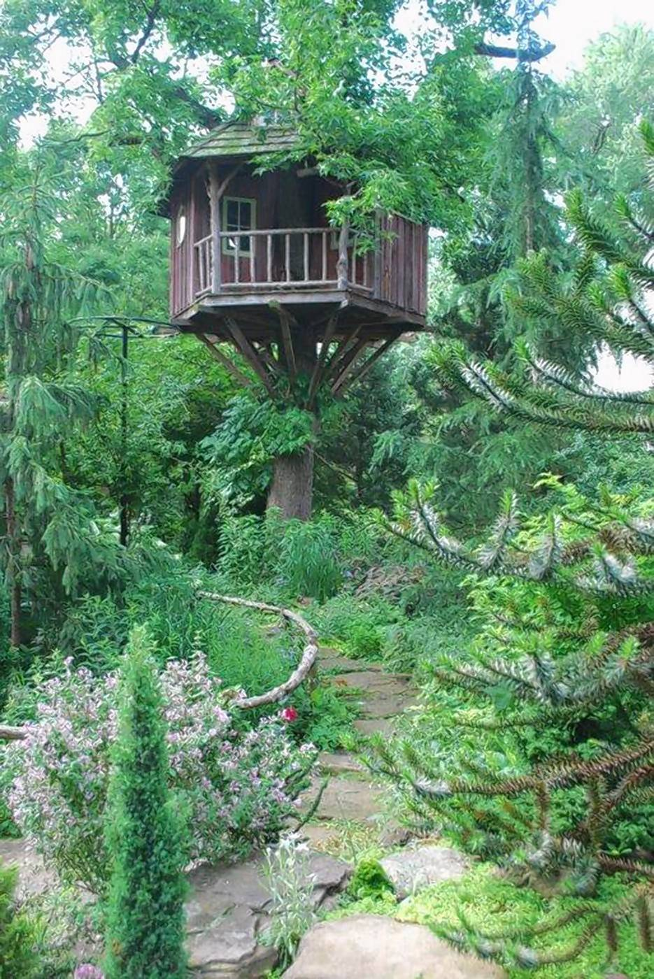 Pierre Moitrier's sense of garden artistry is seen in a beautifully crafted treehouse perched in a sweet gum tree. The interior is handsomely detailed, with an air of a home in the treetops.