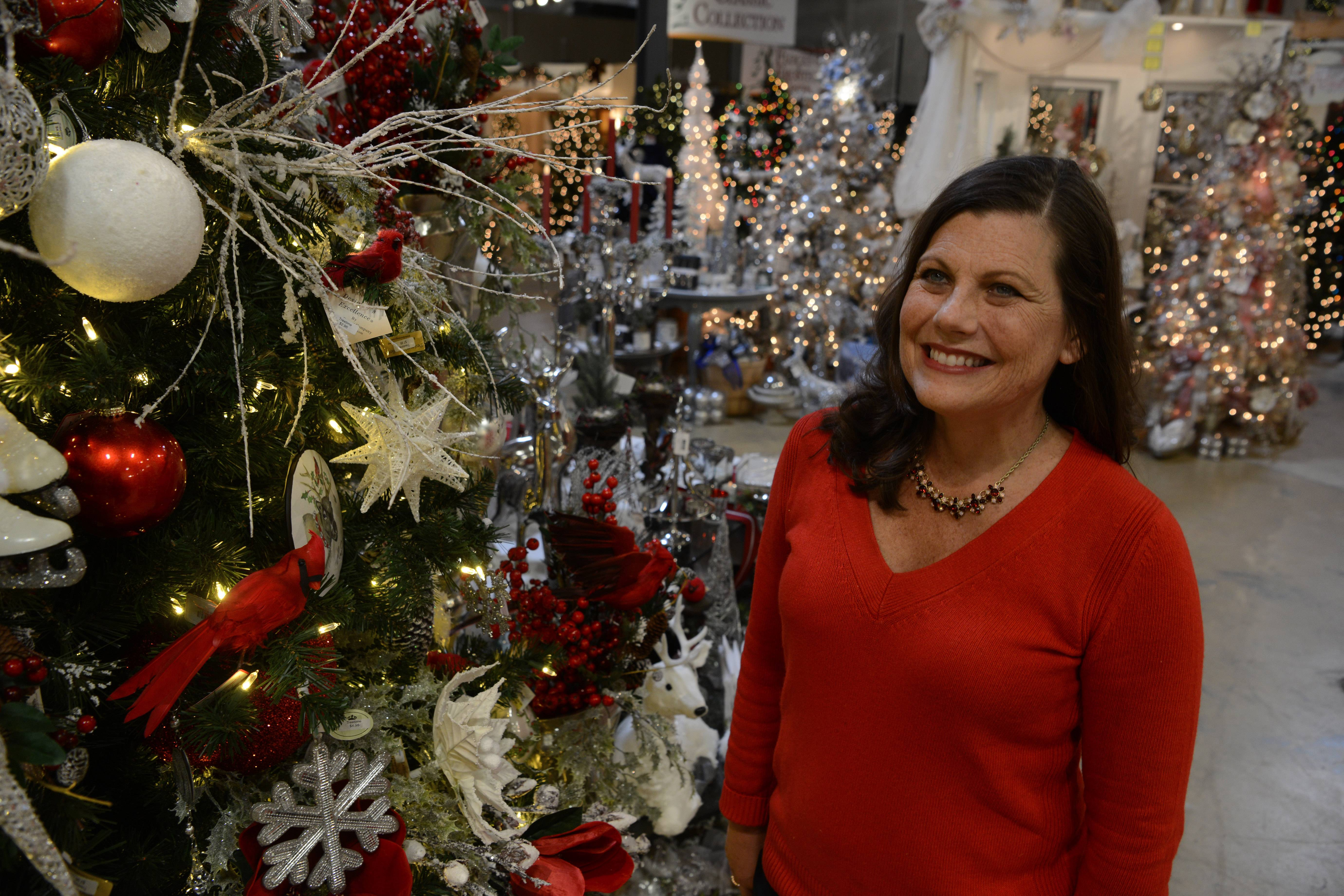 "Laurie Kane views the ""Winter Garden"" tree at Treetime Christmas Creations in Lake Barrington."