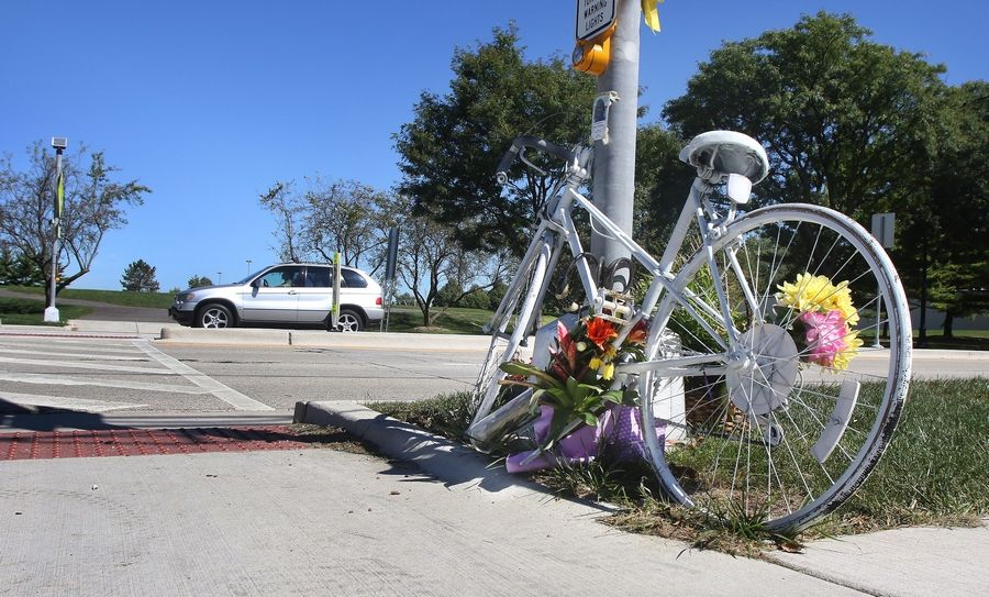 "A ""ghost bike"" stood in tribute to cyclist Joni Beaudry, who was struck and killed by an SUV while crossing busy Central Road in Mount Prospect in 2016. Her family and other residents said the yellow flashing lights at the crosswalk give people a false sense of security."