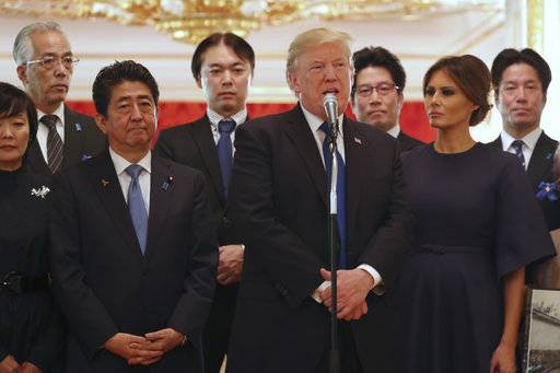 CORRECTS TO JAPANESE ABDUCTED BY NORTH KOREA- President Donald Trump, center, speaks as Trump and first lady Melania Trump, right,  meet with the families of Japanese abducted by North Korea at the Akasaka Palace, Monday, Nov. 6, 2017, in Tokyo. Trump is on a five country trip through Asia traveling to Japan, South Korea, China, Vietnam and the Philippines.  Japanese Prime Minister Shinzo Abe, is at center left while his wife Akie at far left.  At center rear is Koichiro Iizuka, whose mother Yaeko Taguchi was abducted by North Korean agents in 1978.