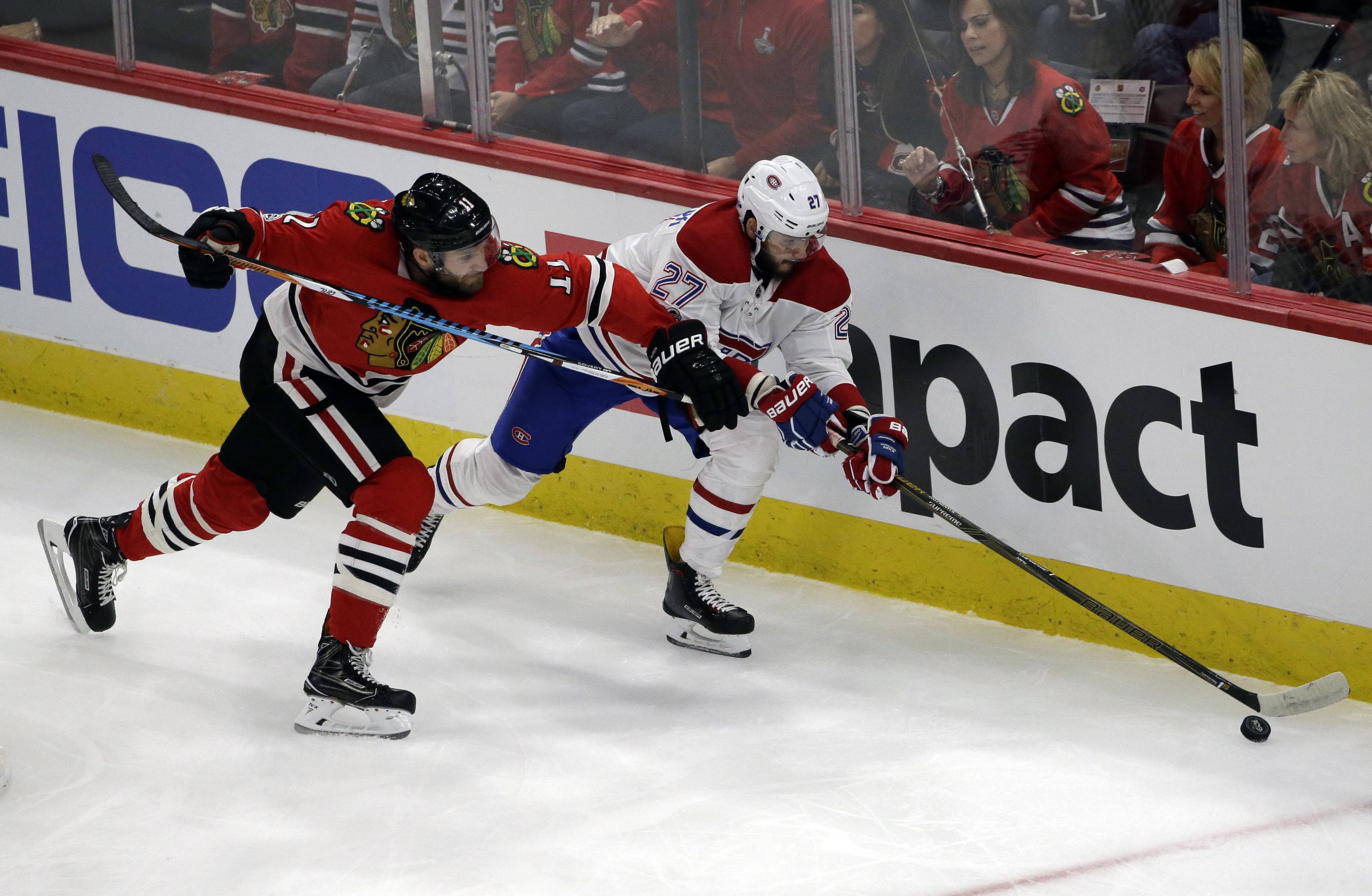 Montreal Canadiens left wing Alex Galchenyuk, right, controls the puck past Chicago Blackhawks defenseman Cody Franson during the first period of an NHL hockey game, Sunday, Nov. 5, 2017, in Chicago.