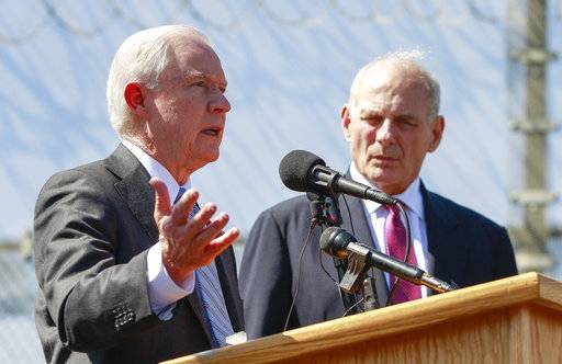 FILE - in this April 21, 2017, file photo, Attorney General Jeff Sessions, left, speaks as Secretary of Homeland Security John Kelly, right, listen during a news conference at the U.S.-Mexican border next to the Brown Field Border Patrol Station in San Diego. The Trump administration has revamped a decade-old deterrence program for prosecuting immigrants in its get-tough approach to immigration. But it's unclear just how effective that program is. (Hayne Palmour IV/The San Diego Union-Tribune via AP, File)