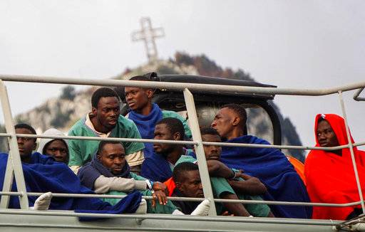 Migrants wait to disembark from the Spanish ship 'Cantabria' in the harbour of Salerno, Italy, Sunday, Nov. 5 2017. UNHCR spokesman Marco Rotunno said that the 26 dead  migrants aboard the ship were involved in a shipwreck two days ago off Libya.  (Cesare Abbate/ANSA via AP)